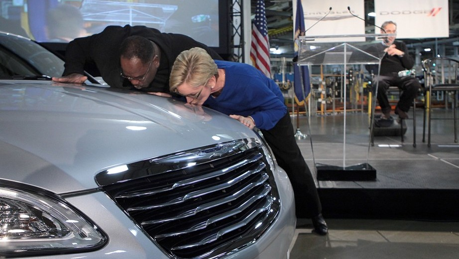 "Vice President/Director (UAW Chrysler Department) General Holiefield and Michigan Governor Jennifer Granholm show their ""appreciation"" to a new 2011 Chrysler 200 for its part in keeping SHAP open."