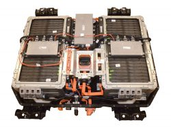 The 2017 Chrysler Pacifica Hybrid features a 16-kWh lithium-ion battery pack (shown with cover off) that is stored under the second row floor.