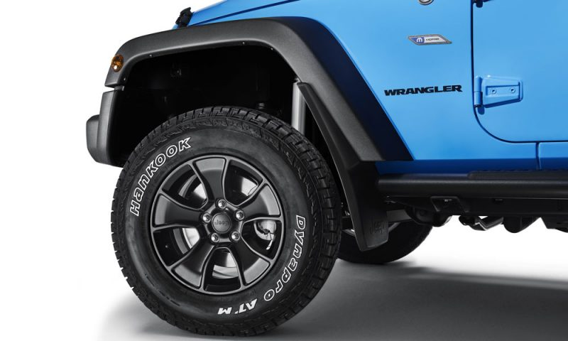 The Mopar ONE package for the Jeep Wrangler includes 17- by 8.5-inch Performance Gladiator black alloy wheels fitted with 265/70 R 17 Hankook Dynapro tires.