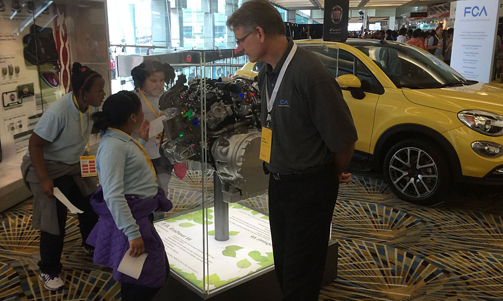 Students get a close look at an EcoDiesel V-6 engine display at the Shell Eco-marathon.