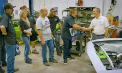"Pietro Gorlier, right, Head of Parts and Service (Mopar) -- FCA Global, shakes hands with Mark Worman of the ""Graveyard Carz"" TV show while meeting the restoration shop's employees and inspecting a 1971 'Cuda that was fitted with a Mopar Crate HEMI Engine Kit for the 2016 SEMA show."